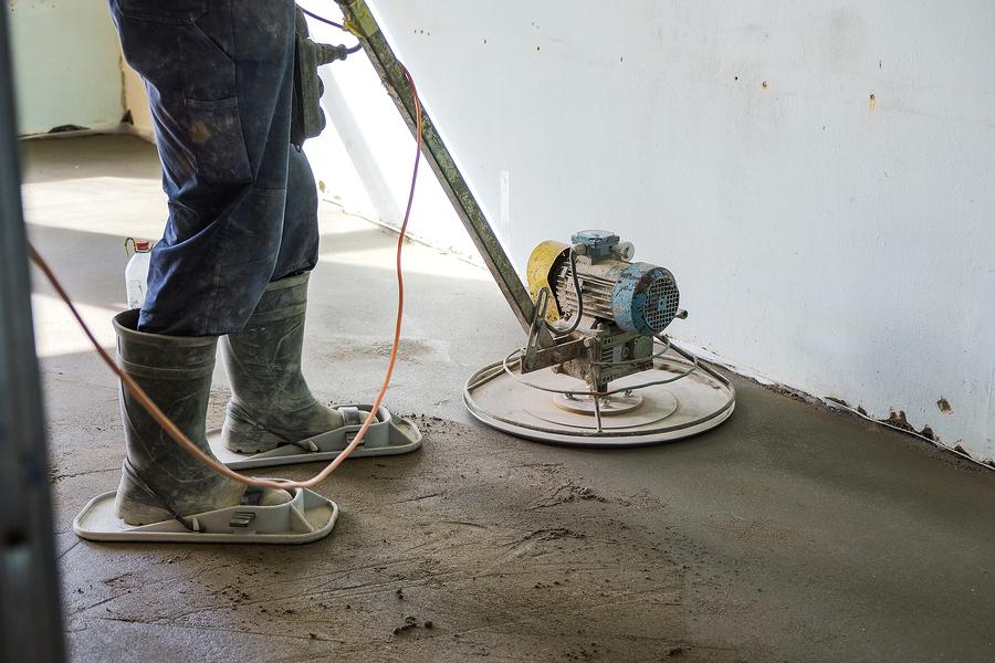 man polishing the cement