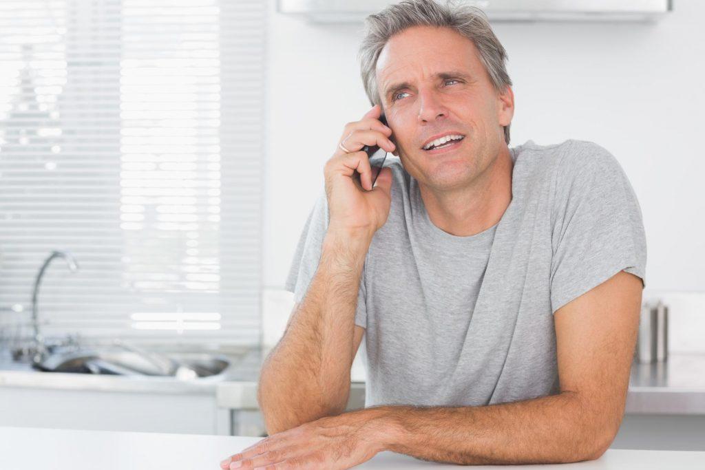 man holdinghis phone