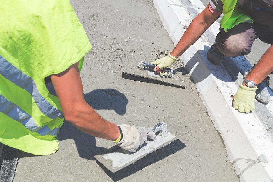 men flattening the cement